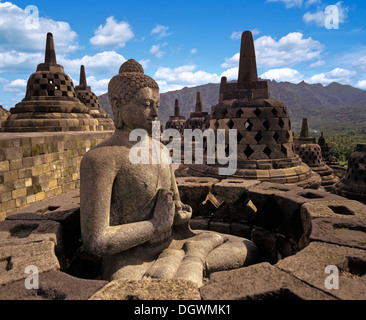Exposed Buddha statue in the temple complex of Borobudur, stupas, UNESCO World Cultural Heritage Site, Borobudur, - Stock Photo