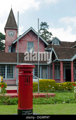 Old post office building, red pillar post box, red brick Victorian-style house, British colonial heritage, Nuwara - Stock Photo