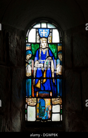 Stained-glass window showing Queen Margaret of Scotland, St. Margaret's Chapel, Edinburgh Castle, Stirling, Scotland - Stock Photo