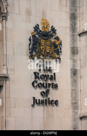 Crest of The Royal Courts of Justice, Supreme Court, in Fleet Street, London, England, United Kingdom, Europe - Stock Photo
