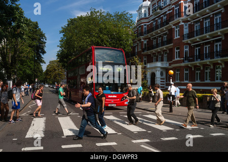 Tourists on the zebra crossing of the famous Beatles album cover, Abbey Road, London, England, United Kingdom, Europe - Stock Photo