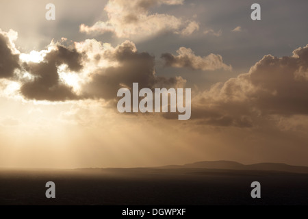 Islands of Orkney, Scotland. Picturesque silhouetted view over the Pentland Firth with the island of Hoy in the - Stock Photo