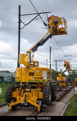 Manchester, UK 26th October, 2013. Timely Tramway closure for Pod-Trak Ltd (RR14 EVO road rail machine), maintenance - Stock Photo
