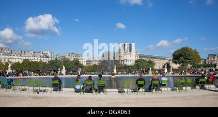 People enjoying autumn sunshine around a pond (Grand Bassin Rond) in the Jardin des Tuileries Paris. The Louvre - Stock Photo