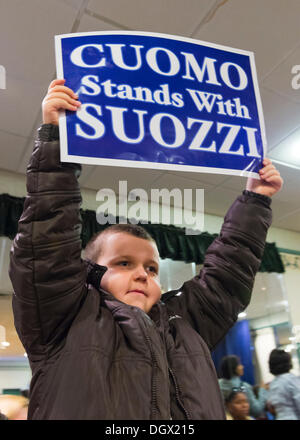 Albertson, New York, U.S. 26th October 2013. THOMAS BIAMONTE, 8, of Oceanside, stands high holding a poster when - Stock Photo