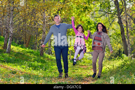 happy young family spending time outdoor - Stock Photo