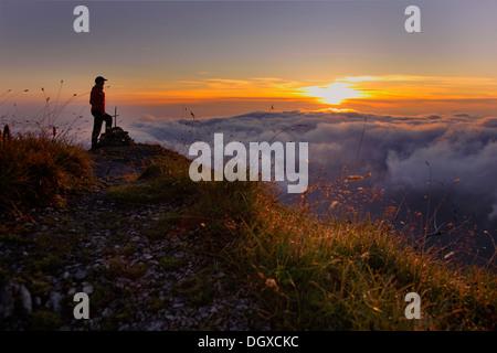 Mountaineer at dawn, Ammergebirge, Ammer Mountains, Garmisch, Bavaria - Stock Photo