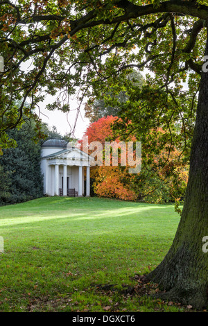 The Temple of Bellona and tree with autumn orange foliage - Kew Gardens, Greater London UK - Stock Photo