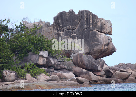 Granitic boulder formations on La Digue Island in The Seychelles - Stock Photo