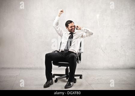 Businessman rejoicing - Stock Photo