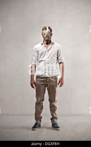 Guy standing with a gas mask - Stock Photo