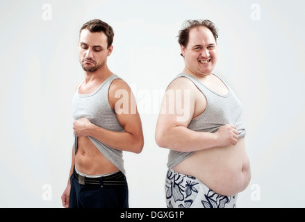 Athletic, muscular man and a fat man showing their bellies - Stock Photo