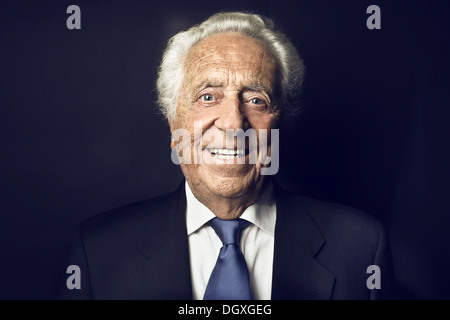 Smiling old man on a black background - Stock Photo