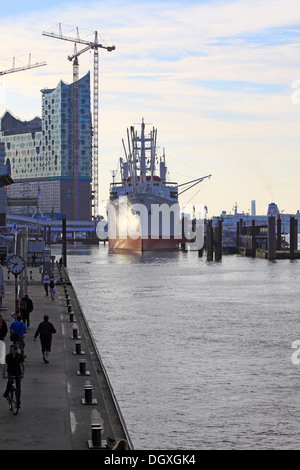 Elbe Philharmonic Hall and the museum ship, Cap San Diego in the Hanseatic City of Hamburg - Stock Photo