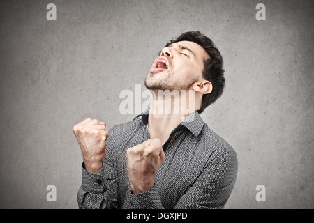 Young man rejoicing for his success - Stock Photo