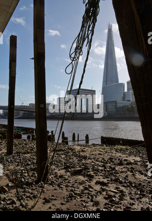 View of the Shard building from beach at the Thames river at low tide. London, England, UK - Stock Photo