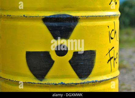 Yellow barrel with radioactive sign - Stock Photo