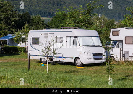 Mobile Home; Camping; Vehicle Trailer; Car; Tent; Summer; Holiday; Vacations; Park; Travel Destinations; Field; - Stock Photo