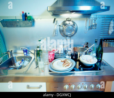 Dirty dishes in a kitchen - Stock Photo