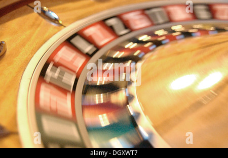Rotating roulette wheel with motion blur - Stock Photo