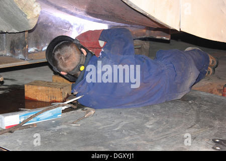A welder arc welding - Stock Photo