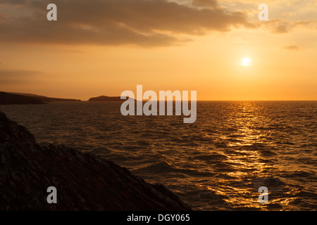 The Sun sets over Mwnt - Stock Photo