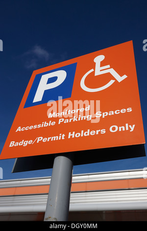 reserved car parking sign at a retail outlet - Stock Photo