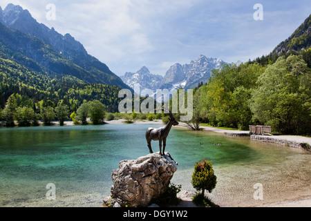 Capricorn sculpture on Lake Jasna in Triglav National Park, Julian Alps, near Kranjska Gora, Slovenia, Europe - Stock Photo