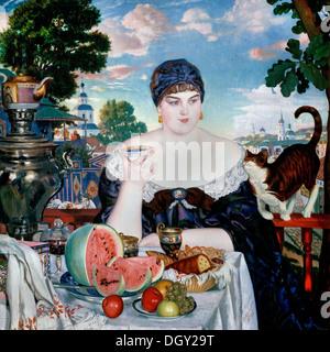 Boris Kustodiev, Merchant's Wife at Tea. 1918 Oil on canvas. State Russian Museum, Saint Petersburg, Russia. - Stock Photo