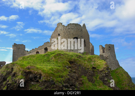 Ancient ruins Dunluce Castle on a cliff on the coast, County Antrim, Northern Ireland, United Kingdom, Europe - Stock Photo