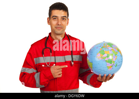 Paramedic pointing to earth globe isolated on white background - Stock Photo