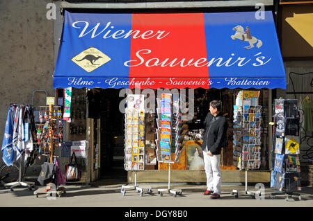 Tourist in front of a store with postcards and souvenirs, Vienna, Austria, Europe - Stock Photo
