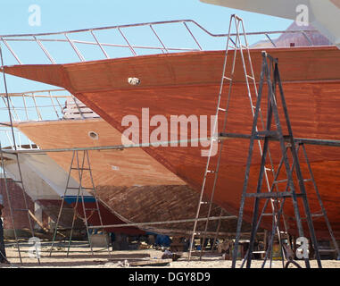 Old wooden boats on a dry dock, Hurghada, Egypt, Africa - Stock Photo