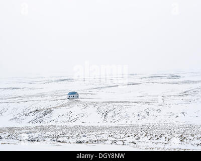 Solitary house in a wintry landscape, North Iceland, Iceland - Stock Photo