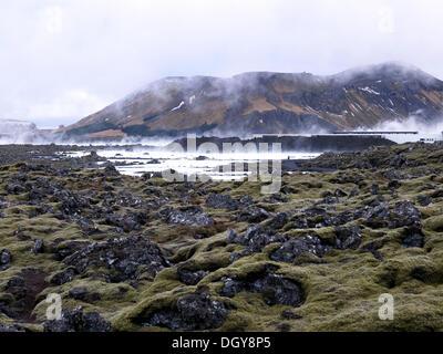 """Blue Lagoon"" with moss-covered lava fields, near Reykjavík, Capital Region, Iceland - Stock Photo"