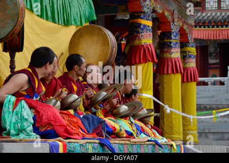 Tibetan Buddhism, monk orchestra, monks with instruments at the religious masked dance 'Cham' festival in the important - Stock Photo