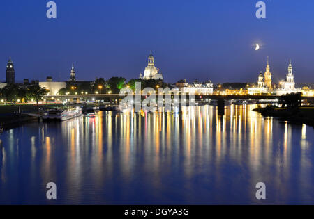 Florence on the Elbe at night, crescent moon above the Elbe river with the illuminated city skyline with Frauenkirche, - Stock Photo