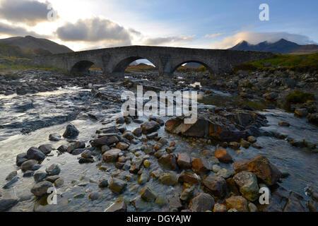 Old stone bridge in front of the Black Cullins Mountains, Sligachan, Isle of Skye, Scotland, United Kingdom, Europe - Stock Photo