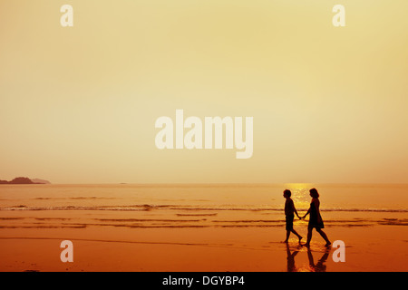 silhouette of couple on the beach - Stock Photo