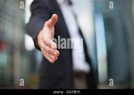 Businessman offering for handshake - Stock Photo