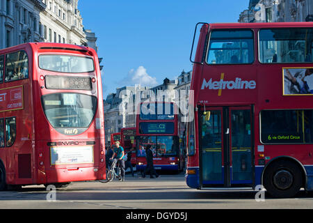 Double decker buses in Oxford Circus, London, England, United Kingdom, Europe - Stock Photo