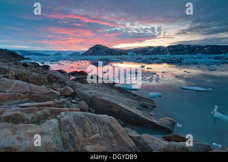 Midnight sun, inland ice, Johan Petersen Fjord, East Greenland - Stock Photo