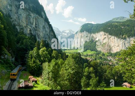 Jungfrau Train and Lauterbrunnen Valley, Switzerland - Stock Photo