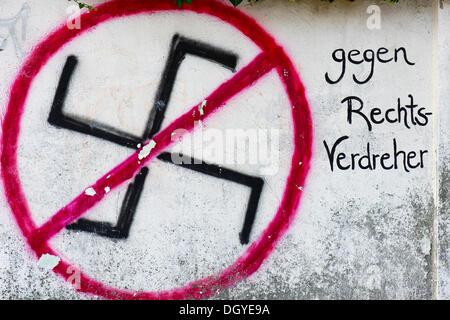 Crossed-out swastika on a wall, lettering 'gegen Rechts-Verdreher', German for 'against right-wing radicals', Tuebingen - Stock Photo