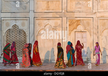 Group of women wearing colourful saris, Taj Mahal, mausoleum, UNESCO World Heritage Site, Agra, Uttar Pradesh, India - Stock Photo