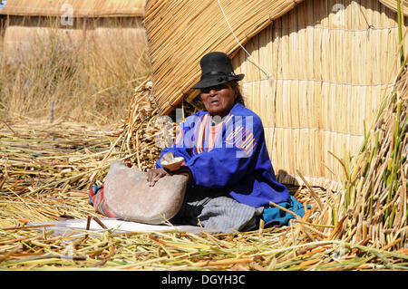 Woman, Uros, floating island, Lake Titicaca, Peru, South America, Latin America - Stock Photo