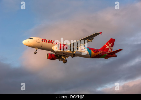 An Airbus A320 of Air Malta on final approach - Stock Photo