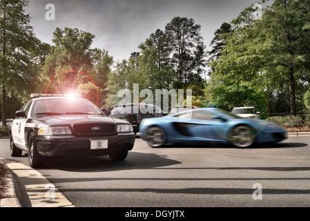McLaren MP4-12C and North Carolina Police car in Chapel Hill North Carolina USA - Stock Photo
