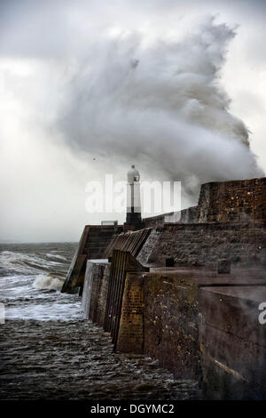 Porthcawl, South Wales, UK. 27th Oct, 2013. A huge wave breaks over the sea wall at Porthcawl, South Wales (27 Oct - Stock Photo