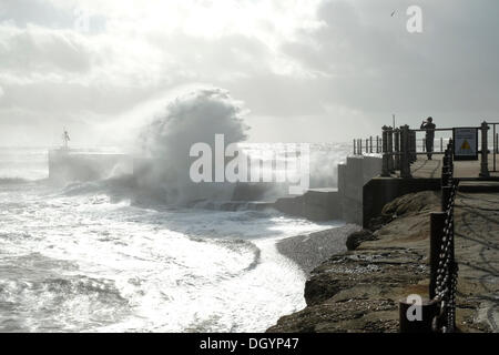 Hastings Harbour, East Sussex, UK. 28th Oct, 2013. Photographer gets close to capture waves breaking over the harbour - Stock Photo
